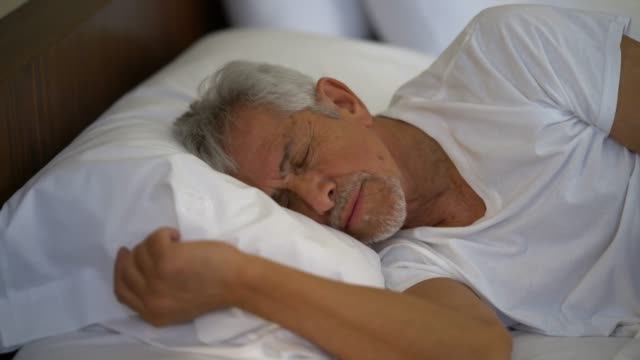 senior man sleeping very comfortable at home - one senior man only stock videos and b-roll footage