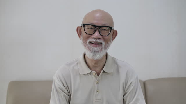 senior man smiling with camera - sequential series stock videos & royalty-free footage