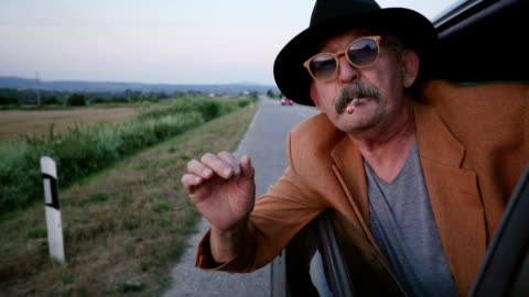 senior man smoking joint - cigarette stock videos & royalty-free footage