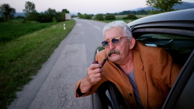 senior man smoking pipe - leaning stock videos & royalty-free footage