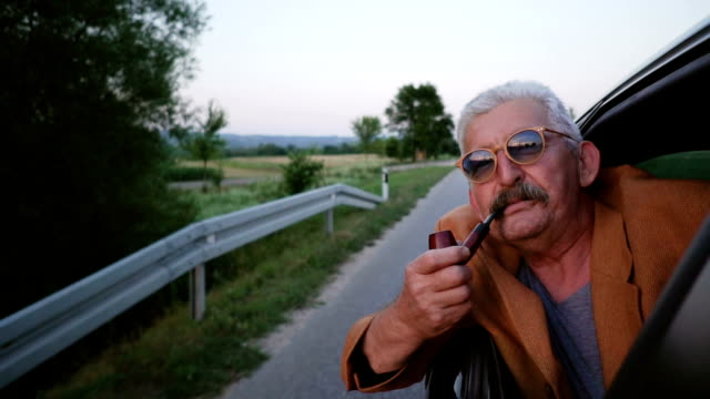 Senior man smoking pipe