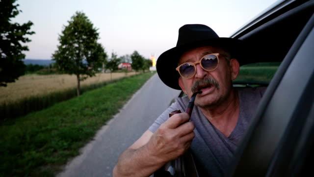 senior man smoking pipe - satisfaction stock videos and b-roll footage