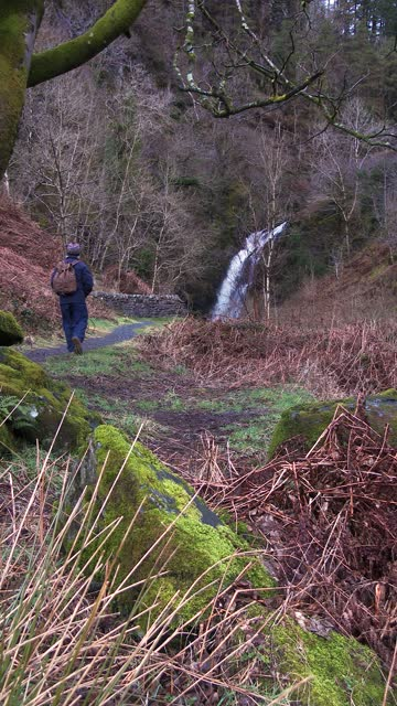 senior man stopping to look at a waterfall - johnfscott stock videos & royalty-free footage