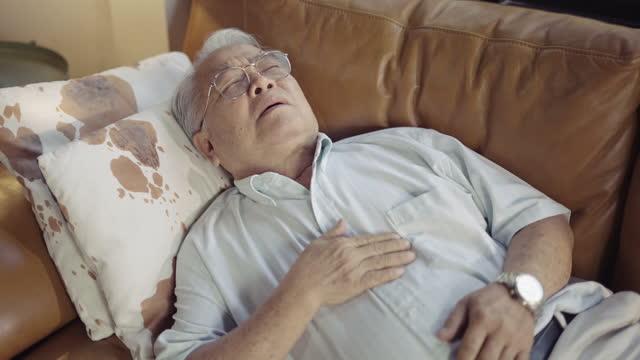 senior man suffering from asthma - torso stock videos & royalty-free footage