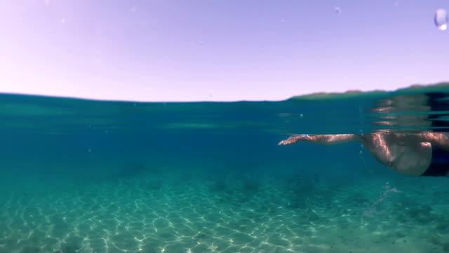 senior man swimming - floating on water stock videos & royalty-free footage