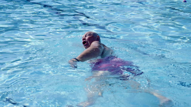 senior man swimming - health spa stock videos and b-roll footage