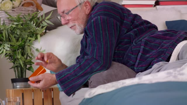 senior man taking his medication in the morning - taking medicine stock videos & royalty-free footage