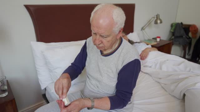senior man taking his medication - taking medicine stock videos & royalty-free footage