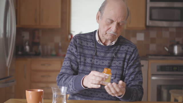 senior man taking medication - prescription medicine stock videos & royalty-free footage