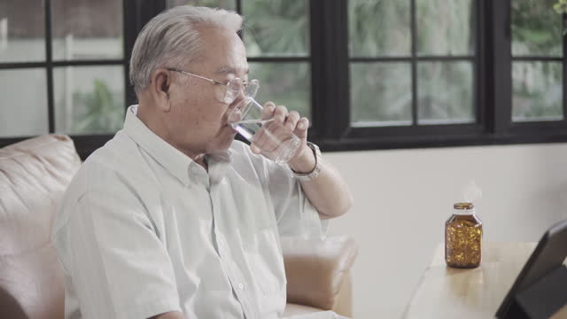 senior man taking medicine. - nutritional supplement stock videos & royalty-free footage