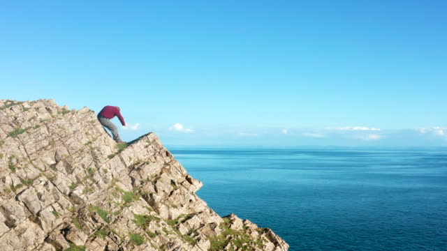 senior man taking photo of view with smartphone on the cliffs above rhossili - horizon over water stock videos & royalty-free footage