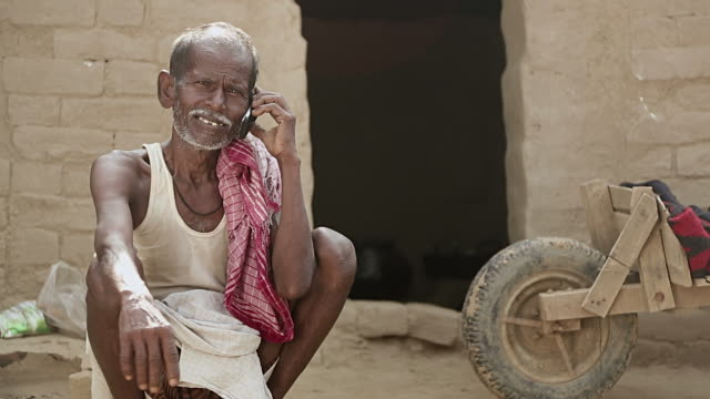 senior man talking on a mobile phone, haryana, india - one senior man only stock videos and b-roll footage