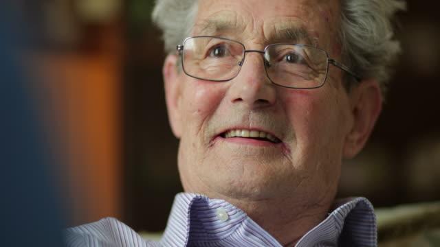 senior man talking to his carer - senior men stock videos & royalty-free footage
