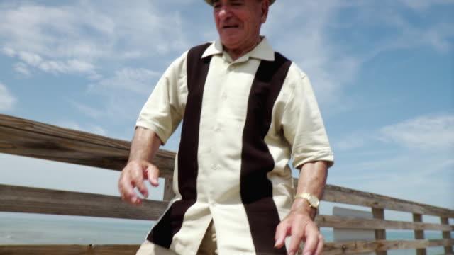 ms tu td senior man tap dancing on pier / jacksonville beach, florida, usa    - tap dancing stock videos & royalty-free footage