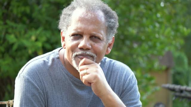 senior man thinking - hand on chin stock videos & royalty-free footage