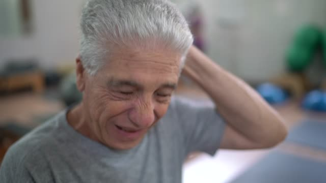 senior man tired in physiotherapy clinic - headache stock videos & royalty-free footage