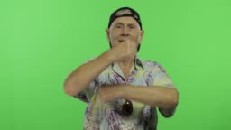Senior man tourist in colorful shirt dances. Handsome old man on chroma key