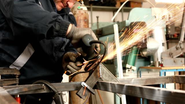 senior man using electric grinder in workshop - blade stock videos & royalty-free footage