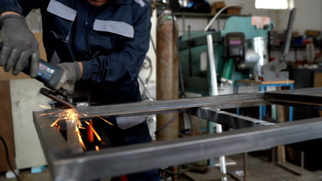 senior man using electric grinder in workshop - sander stock videos & royalty-free footage