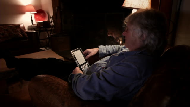 ms senior man using electronic reader / kingston, new york, usa  - kindle stock videos & royalty-free footage