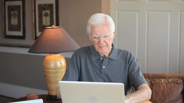 ms td senior man using laptop at home, eastville, virginia, usa - eastville stock videos and b-roll footage