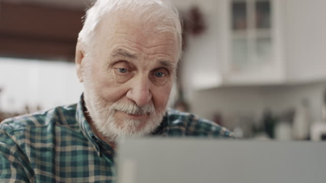 senior man using laptop - beard stock videos & royalty-free footage