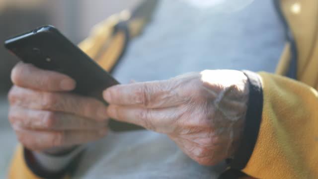 senior man using mobile phone - retirement community stock videos & royalty-free footage