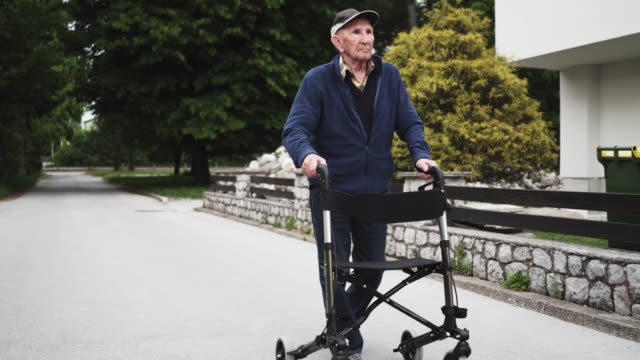senior man using mobility walker - mobility walker stock videos and b-roll footage