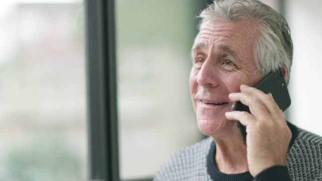 Senior man using smartphone
