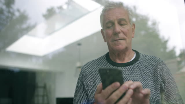 senior man using smartphone - one senior man only stock videos & royalty-free footage