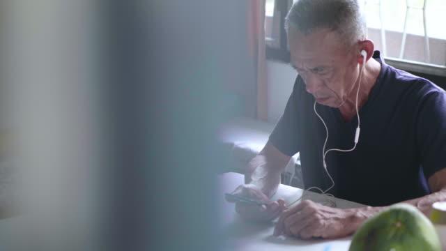 senior man using smartphone