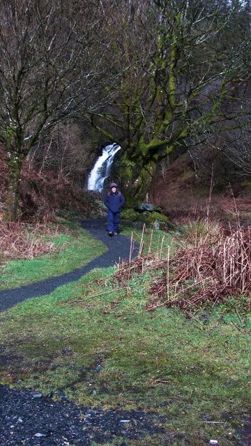 senior man walking away from a waterfall - johnfscott stock videos & royalty-free footage