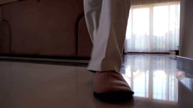 senior man walking trough the house - slipper stock videos & royalty-free footage