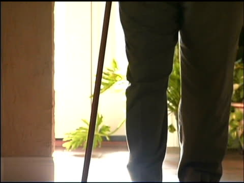 senior man walking with cane - walking cane stock videos and b-roll footage
