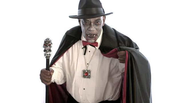 senior man wearing vampire costume - vampire stock videos and b-roll footage