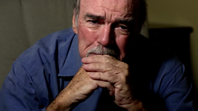 senior man weeps in despair - grief stock videos & royalty-free footage