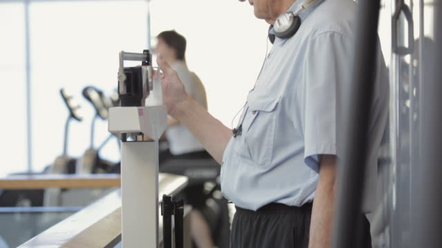 ms tu senior man weighting scales on slide rule / vancouver, british columbia, canada - slide rule stock videos & royalty-free footage