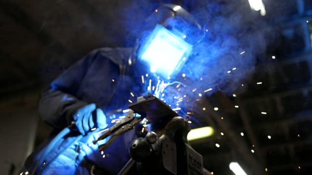 senior man welding farming equipment - work helmet stock videos & royalty-free footage