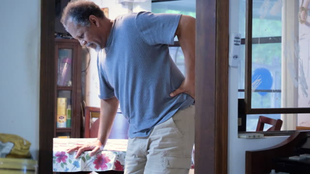 senior man with backache, standing up - hip stock videos & royalty-free footage