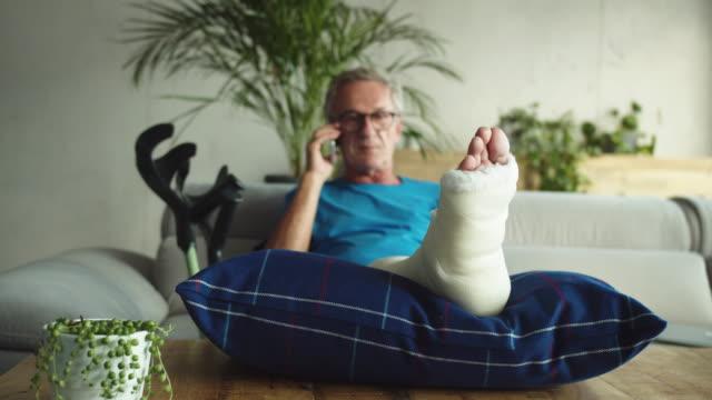 senior man with broken leg - crutch stock videos & royalty-free footage