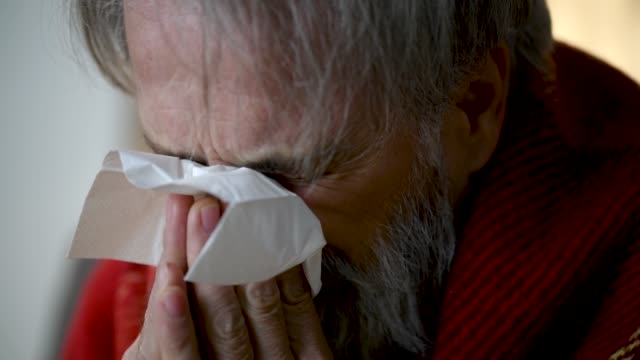 senior man with flu virus wiping nose - sneezing stock videos & royalty-free footage