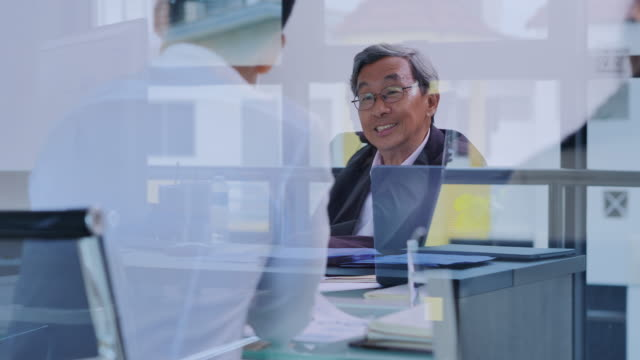 senior man working and communicating while sitting at the office desk together.business people discussing in board room.business,success,people,technology,teamwork conceptมbusiness: leadership - asian and indian ethnicities stock videos & royalty-free footage
