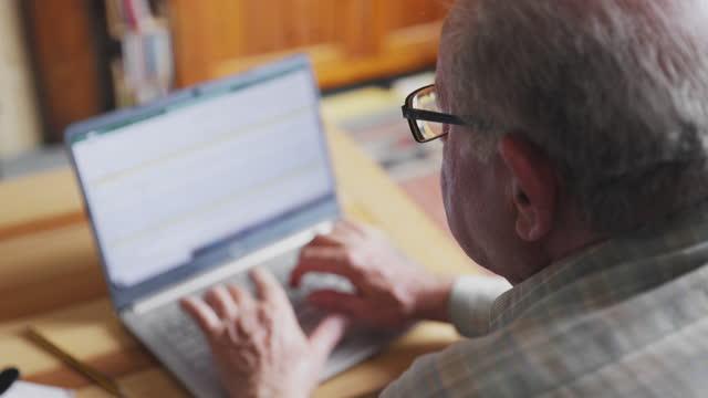 senior man working at home - rack focus stock videos & royalty-free footage