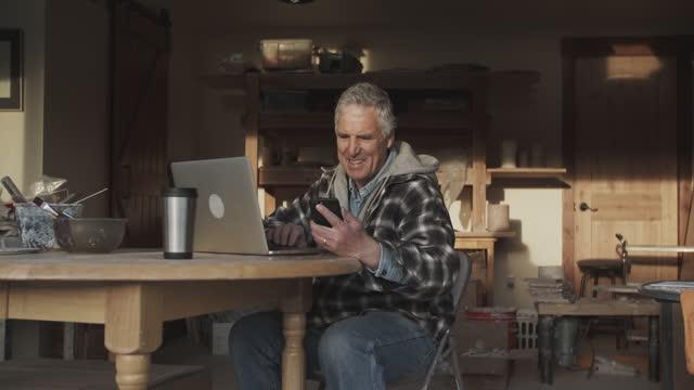senior man working in his workshop - electronic banking stock videos & royalty-free footage