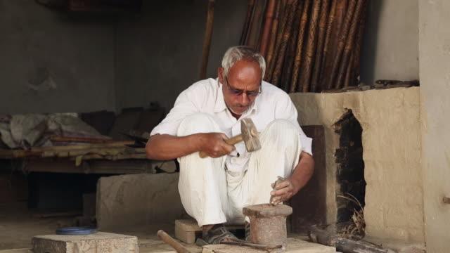 Senior man working in the workshop, Haryana, India