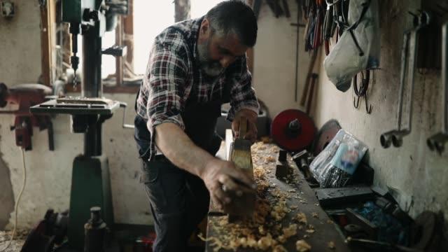senior man working on cutting wood - plaid shirt stock videos & royalty-free footage