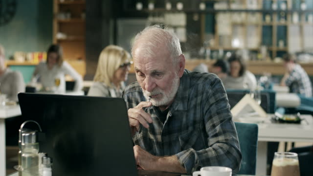 senior man working on laptop and wapping in restaurant - over 80 stock videos and b-roll footage
