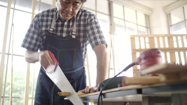 senior man working on workshop - decorating stock videos & royalty-free footage