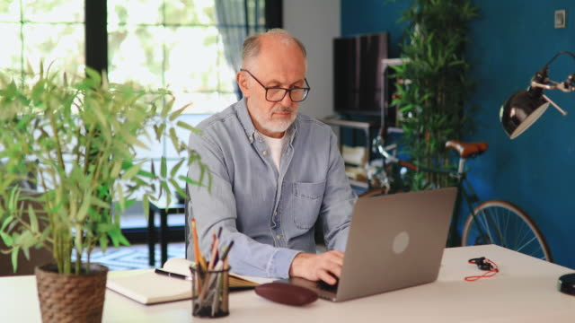 senior man working online from home office - unemployment stock videos & royalty-free footage