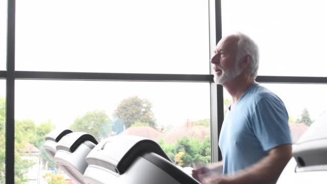 Senior man working out at gym
